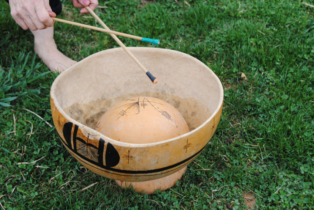 Playing water gourd drum 1024x685